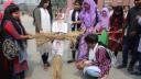শিক্ষককে কটুক্তিকারী কর্মচারীর কুশপুত্তলিকা দাহ