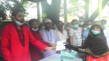কসবায় ৩৩০ জনের মধ্যে ভাতা উত্তোলনের বই প্রদান