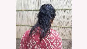 নেশার টাকা না পেয়ে স্ত্রীর চুল কেটে দিল স্বামী